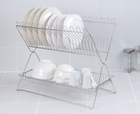 Stainless steel shelf for keeping dishes and cups on gray tile background Stock Photo - 20028077