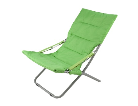 Green canvas deckchair isolated on white background photo