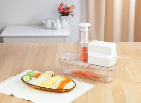 slicer: Electric slicer machine display with sliced vegetable