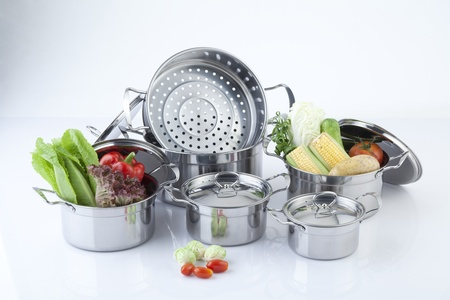 Set of stainless pots with lids photo