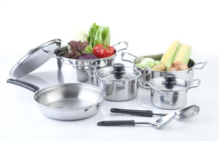 kitchenware: Set of stainless pots with lids and vegetables