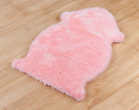 Decorative fur carpet on wooden floor photo