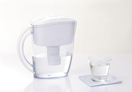 water jug: water filter jug and a glass of water