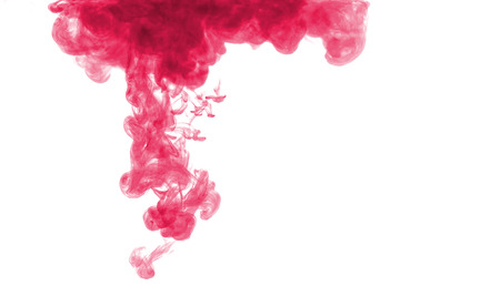 color mixing: abstract formed by red color dissolving in water