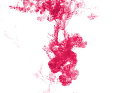 abstract formed by red color dissolving in water