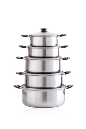 cooking pot: Set of stainless pots with glass lids isolated on white Stock Photo