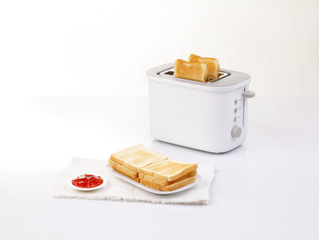 toaster: bread toaster and toasted bread served with jam