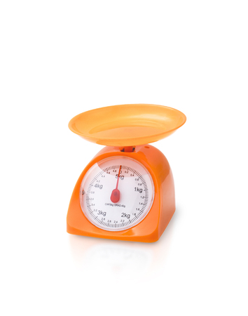 kitchen scale: orange color kitchen scale isolated on white background