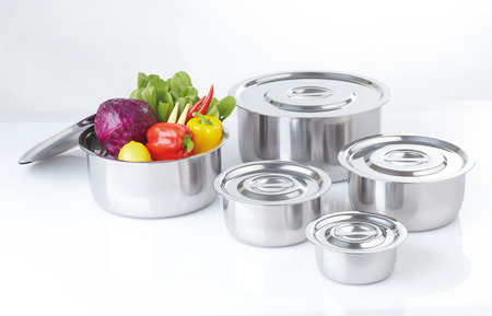 lids: Set of stainless pots with lids and vegetable