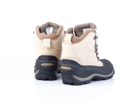 proof: pair of weather proof snow boots on white background