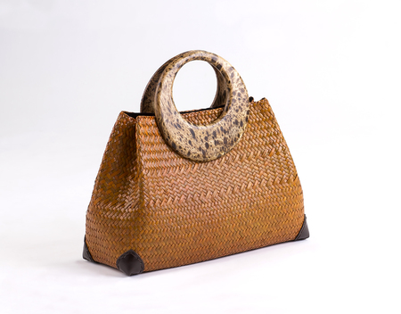Brown wicker handbag isolated on white background Stock Photo