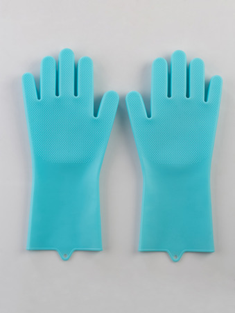 Blue rubber gloves for cleaning isolated on white background