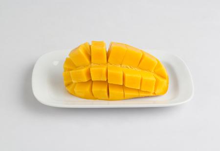 Fresh mango sliced diced isolated on white background