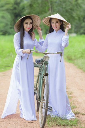 lovelorn: Portrait of VIetnam girl with Ao Dai at cornfield, Vietnam traditional dress,Ao dai is famous traditional costume for woman in VIetnam.
