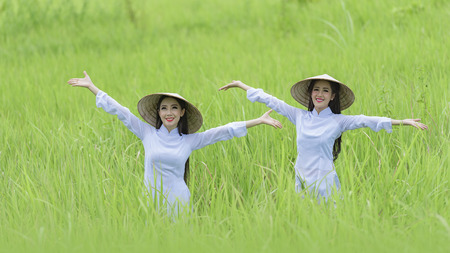 Portrait of VIetnam girl with Ao Dai at cornfield, Vietnam traditional dress,Ao dai is famous traditional costume for woman in VIetnam. Stock fotó