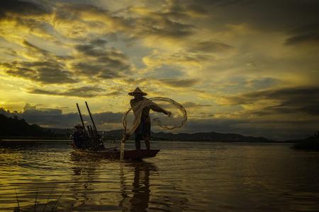 Fishermen on boat fishing at lake