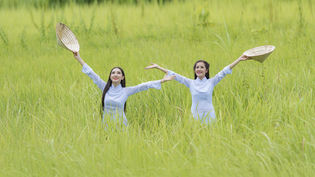 Portrait of VIetnam girl with Ao Dai at cornfield, Vietnam traditional dress,Ao dai is famous traditional costume for woman in VIetnam.