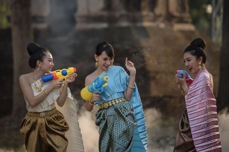 festival Songkran, Thai girls and laos girls splashing water during festival Songkran festival,Water blessing ceremony of adults. 新聞圖片