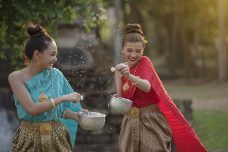 festival Songkran, Thai girls and laos girls splashing water during festival Songkran festival,Water blessing ceremony of adults. Редакционное