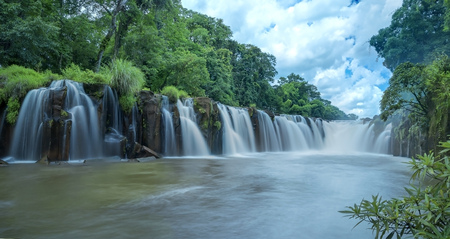 Mountain with waterfall cascades in Laos. Stock Photo