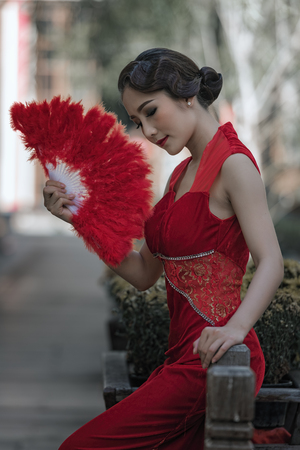Asian woman with Chinese traditional dress cheongsam .Chinese new year concept. Stock Photo
