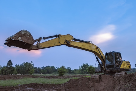 skid steer loader: View from backhoe was digging a pit in the ground for rainwater,Crawler excavator truck  ,Construction digger machine in flat. Backhoe loader, Heavy equipment.