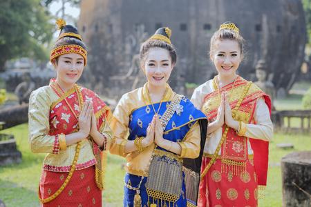 sunshade: Beautiful Laos girl in Laos costume,Asian woman wearing traditional Laos culture,vintage style,Laos traditional suit,Laos vintage style,Laos dress,Laos,Lao traditional dress of a beautiful woman.