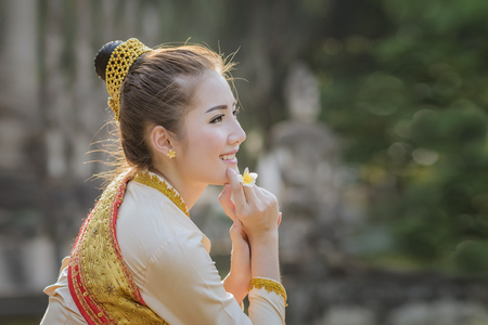Beautiful Laos girl in Laos costume,Asian woman wearing traditional Laos culture,vintage style,Laos traditional suit,Laos vintage style,Laos dress,Laos,Lao traditional dress of a beautiful woman.