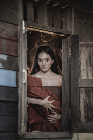 she devil: Thai traditional uniform dress, Thailand ancient traditional skirt,The uniqueness of the dress of Thai traditional  style,woman wearing typical thai dress,Ghost,halloween woman and devil woman concept. Stock Photo