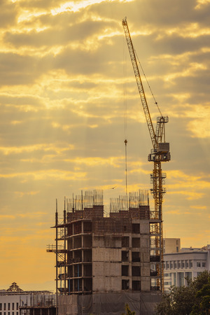 Business Industrial,People,personal and career growth silhouette Businessman engineer looking blueprint in a building site  and potential concepts,concept over blurred natural background sunset pastel.