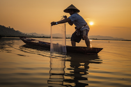 Fishermen fishing in the morning. Stock Photo
