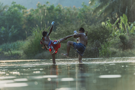 Thai boxing at the river.Boxing and fighting to protect. Stok Fotoğraf