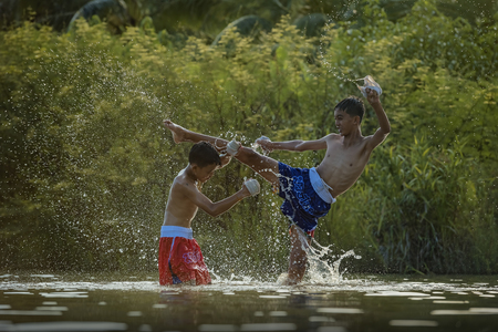 Thai boxing at the river. Stock Photo