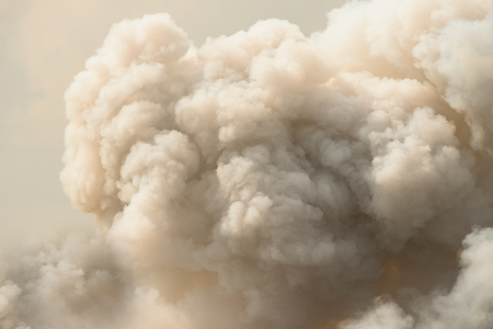 Dense white smoke rising from the raging wildfire,close up swirling white smoke background. Фото со стока - 88715682