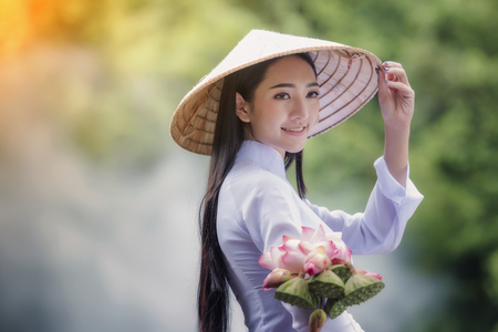 Beautiful woman with vintage style ,Vietnam culture traditional,Beautiful woman with Vietnam culture traditional,Hoi an,Life of Vietnamese Stock Photo