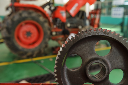 tractor part of the combine at the plant awaits assembly, tractors and agricultural machinery, maintenance and exports. Stock Photo