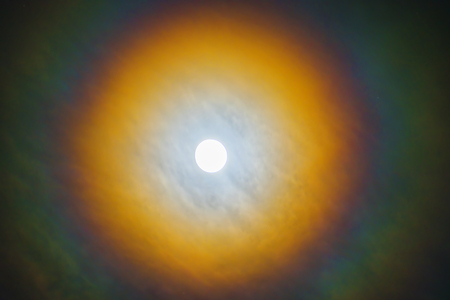 moonlight, the moon to be surrounded by a corona and encircled by a halo.