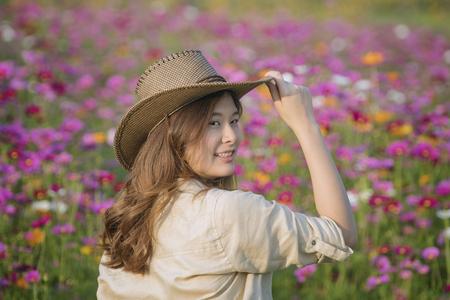 Pretty girl slender brunette in a safari dress,Pretty girl in a safari dress at flower garden.