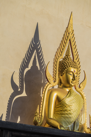 Buddha and shadows caused by sunlight .