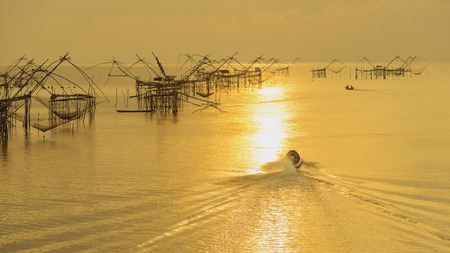 Fishing boats in the morning, with soft sunlight .