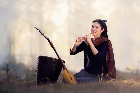 Detail of a musician woman playing Acoustic musical instrument,concept for live music festival.Instrument on stage.