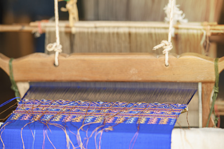 Praewa Ban Phon Weave Silk,Silkworm in Kalasin,Thailand,Silk clothes from nature material,Weaving carpet with traditional techniques on  loom,Wool yarns used as a warp and weft is crucial for this art