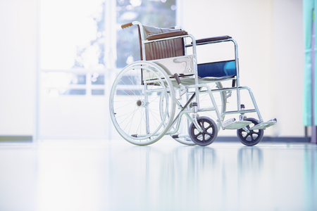 Wheelchairs in the hospital,patient is sitting in a wheelchair,He holds his hands on the wheel,Self-care patients with mobility. Stock Photo