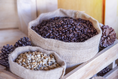 Brown roasted coffee beans.coffee beans on wooden background,Espresso dark, aroma, black caffeine drink.