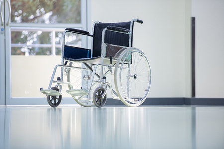 Wheelchairs in the hospital,patient is sitting in a wheelchair,He holds his hands on the wheel,Self-care patients with mobility. Stock fotó