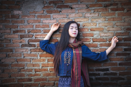 Beautiful Asian girl in traditional simple dress costume.Pretty girl cute laughs in a frame on background. Laughter, joy, mercy, youth, good joke, emotional reaction,funny and friendly, sincerity.