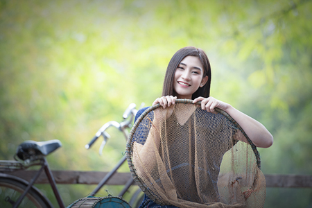 Thai girl in traditional thai costume, identity culture of Thailand.Portrait of a happy young asian woman.Asian woman wearing typical Thai dress identity culture of Thailand.