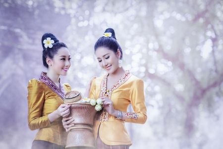 Beautiful Laos Women wearing Laos traditional dress costume,Asian girl wearing traditional Laos culture,vintage style,traditional of Laos suit. Фото со стока
