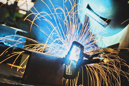 Steel welding,welder,craftsman,Worker labourer at the factory welding steel structure, erection technical steel Industrial steel welder in factory technical.