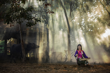 Young country girl portrait outdoors.Asian women in outdoor nature farm.Beautiful rural girl in tribal costume dress working at countryside. Stock fotó